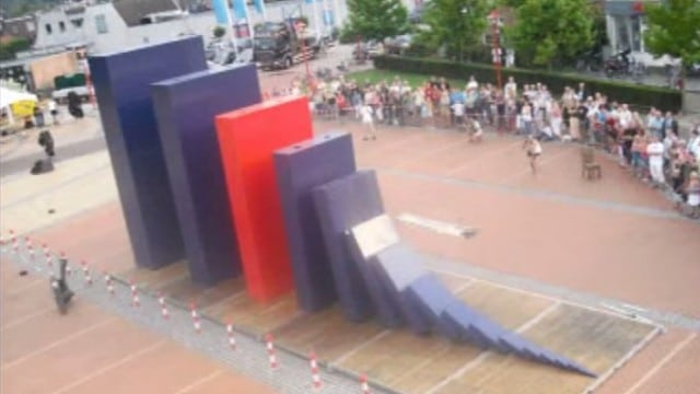 World record for the largest domino toppled in a chain