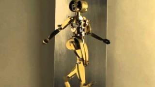 Walking mechanical woman and man