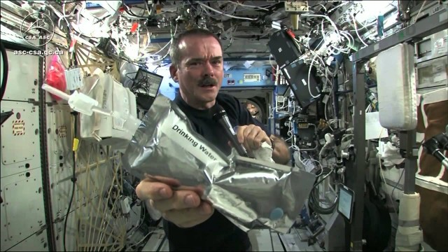 Commander Hadfield: Wringing out Water on the ISS and Space Oddity