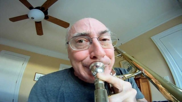 What does it look like to be a trombone playing music?