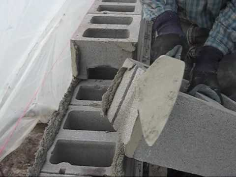 A demonstration of brick laying