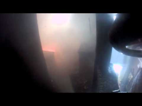 Helmet-mounted camera: A firefighter heads into a two-story home on fire