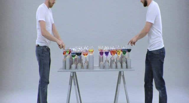 Playing music on a rainbow-colored glass harp