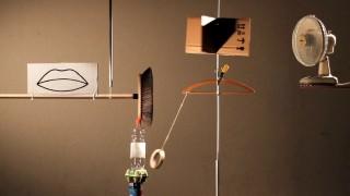 A Mouth, Arm, and Eye, Rube Goldberg-style – Kuratorium