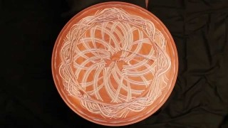 Dance on the circle: wet clay patterns on a spinning potter's wheel