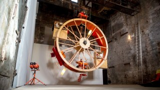 In Orbit: Two people live in a giant hamster wheel