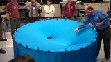 A space-time warping demo for the classroom