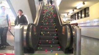 What happens when you pour ball pit balls onto an escalator?