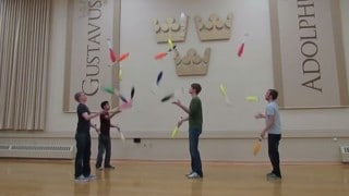 Club & ring juggling tricks with a team of four jugglers