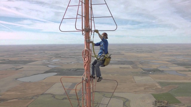 Changing a light bulb at the top of a 1500 foot TV tower