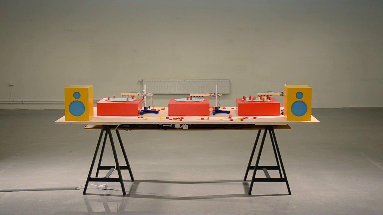 Wooden blocks trigger sounds on Arduino-programmed turntables