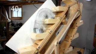 The Slinky machine: A hand-cranked, wooden Slinky escalator