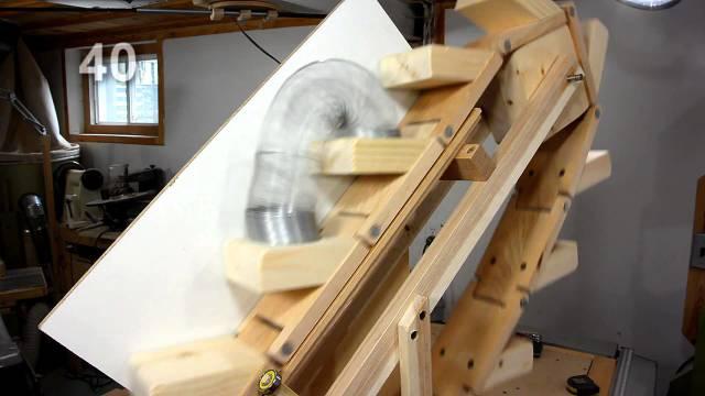 The Slinky machine: A hand-cranked, wooden Slinky escalator