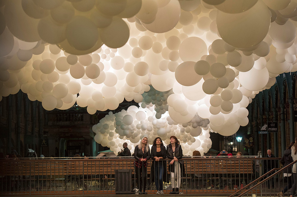 100 000 white balloons create clouds in covent garden
