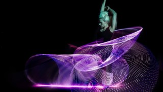 Hula hoop dancer Lisa Lottie spins 6 glowing LED hula hoops