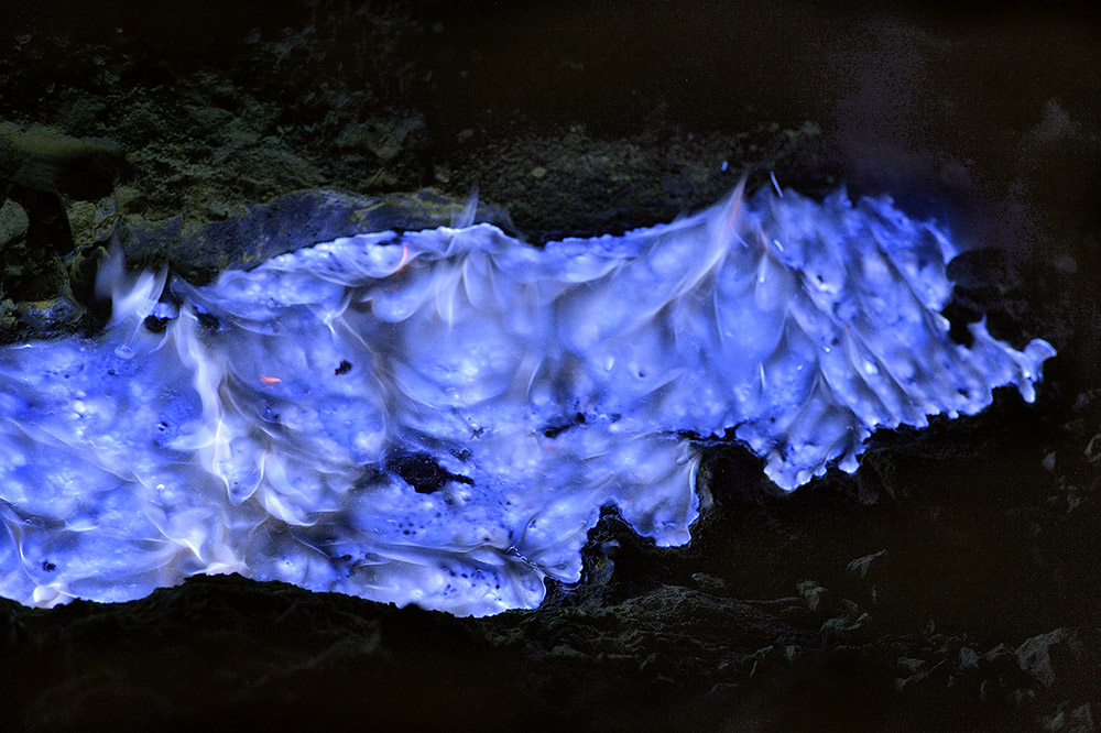 River of sulphur near the acid lake of the Kawah Ijen volcano in Indonesia
