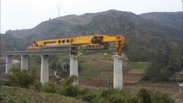 A monster-sized bridge building machine in action