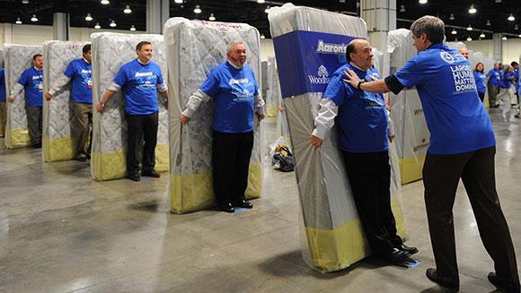 1,200 human mattress dominoes set a Guinness World Record