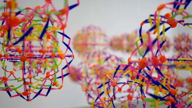 Hoberman spheres transform in this colorful kinetic installation
