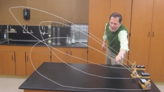 A home made string shooter & slow moving waves in rope