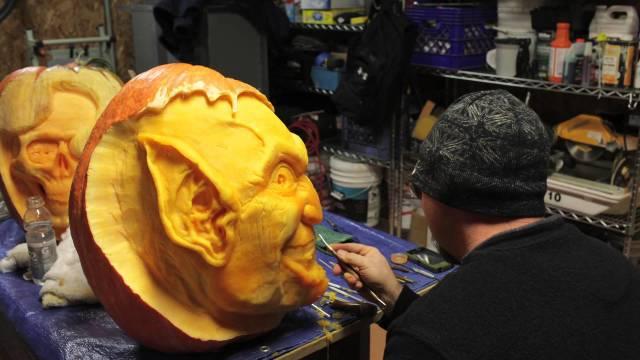 Carving a spooky goblin face, a 3D pumpkin time lapse