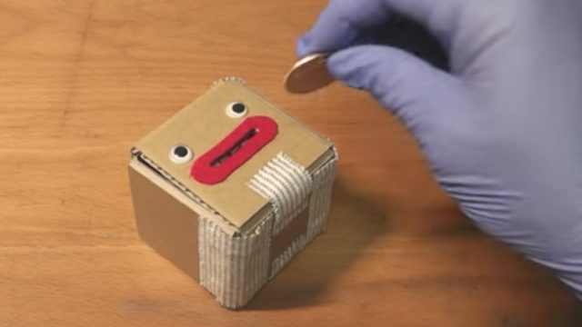 Don't put any coins in this cardboard coin box