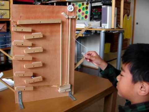 A ramp and pulley marble machine game