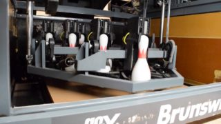 How does a bowling alley work?