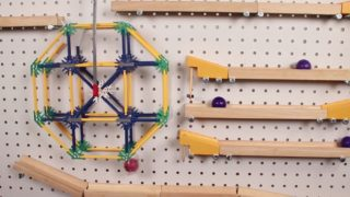 Red Ball Adventure, a chain reaction marble run on a pegboard wall